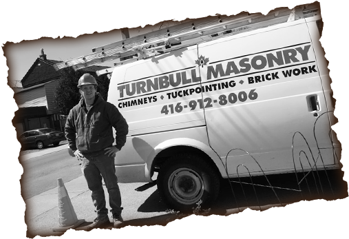 Turnbull Masonry truck with Clint Turnbull standing in front of it.