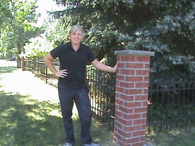 Clint Turnbull standing next to brick post.