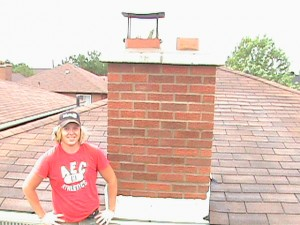 Clint Turnbull in front of repaired chimney in Toronto.