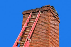 Old chimney being repaired by mason