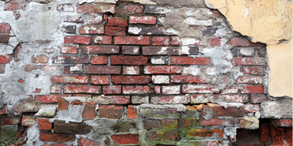 What Can Cause Water Damage Behind Brick Wall?